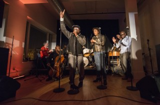 Artist-in-residence Avery R. Young, Tina Howell and Yaw sing with the group Low Tide during the March 2013 opening reception at the Arts Incubator. The center...