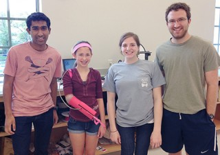 Washington University in St. Louis seniors (from left) Kranti Peddada, Kendall Gretsch and Henry Lather designed and built a robotic prosthetic arm for 13-year-old...