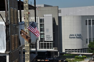 A crane lifts the final beam to the top of Loyola University Chicago's Center for Translational Research and Education.