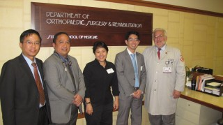 Terry Light, MD (right), chair of the Loyola's Department of Orthopaedic Surgery and Rehabilitation, hosted four orthopaedic surgeons from Southeast Asia.