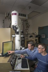 Sandia National Laboratories researchers Dale Huber, left, and Todd Monson have come up with an inexpensive way to synthesize titanium-dioxide nanoparticles,...
