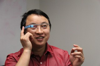 Wichita State professor Jibo He tests Google Glass as part of his research on driver distraction.