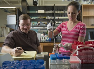 Newly designated HHMI Professor Joseph Jez, an associate professor of biology at Washington University in St. Louis, working in his lab with Ashley Muehler-Sherp,...