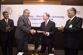 Devang Khakhar, PhD, (left), director of the Indian Institute of Technology Bombay, shakes hands with Mark S. Wrighton, chancellor of Washington University...