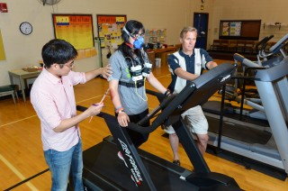The work continues. Gregory Welk (right) and doctoral students Youngwon Kim (left) and Yang Bai (center) are now testing the accuracy of the latest fitness...