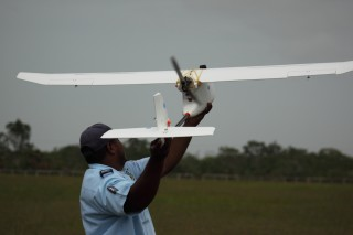 Michael Sabal, an official from the Belize Fisheries Department about to deploy a conservation drone. The government of Belize will use drones to enforce...