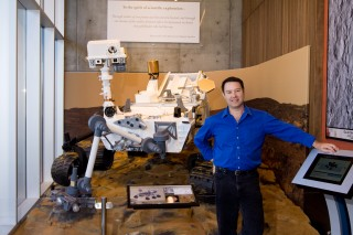 Jim Bell, a professor in ASU's School of Earth and Space Exploration, stands in front of a model of Mars Science Laboratory (MSL, aka Curiosity rover)...