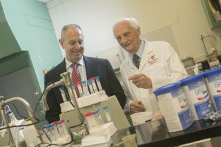 Stony Brook University School of Dental Medicine's Dr. Israel Kleinberg, right, developed a saliva-mimicking technology that led to the creation of a chocolate-flavored...