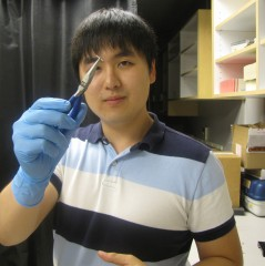 Ganghun Kim, an electrical engineering graduate student at the University of Utah, holds a needle or cannula that is a key component of a new 3-D microscopy...