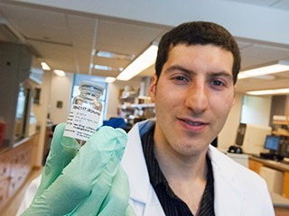<b>Antibody cocktail.</b> Rockefeller's Ariel Halper-Stromberg with a vial containing broadly neutralizing antibodies. When combined with compounds that...