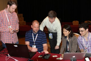 Program Manager Edward Rhyne (center) and Program Manager Karyn Higa-Smith demonstrate S&T's Backend Attribute Exchange Protocol for Personal Identity...