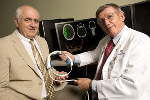 UAMS researcher William Culp, M.D., (right), and Doug Wilson of UALR (left) have developed a device to treat stroke