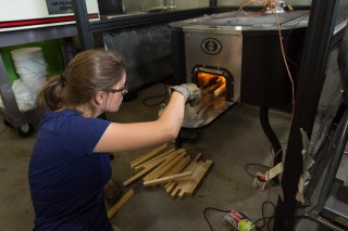 CSU mechanical engineering Ph.D. student Kelsey Bilsback tests cookstoves at the Powerhouse Energy Institute.