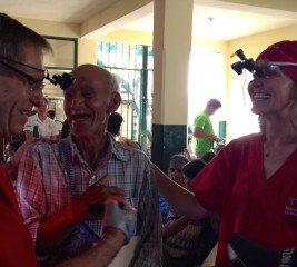 An ecstatic Bernardo Reyes celebrates with Alan Crandall, M.D. And Susan MacDonald, M.D., after his bandages are removed following cataract surgery in Salama,...