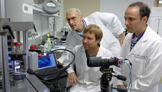 From left, Guy Genin, PhD, John Boyle and Stavros Thomopoulos, PhD, watch as a sample is exposed to stress and force. They have developed algorithms that...