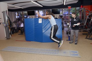 A student is tested for the broad jump 