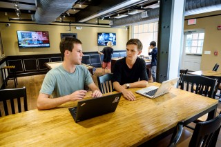 Wake Forest students John Marbach and Nikolai Hlebowitsh chat about their experiences in the tech industry in Zick's pizza joint on campus.