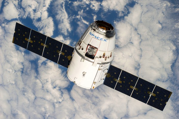 The SpaceX Dragon commercial cargo craft approaches the International Space Station for grapple and berthing.
