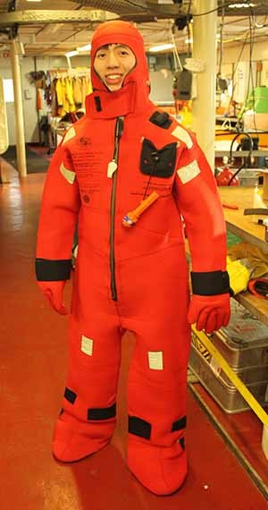 S. Shawn Wei, first author of the Nature paper, kitted up for an emergency drill aboard the research vessel Melville during a campaign to drop ocean-bottom seismographs across the Mariana Trench, also known as the Challenger Deep.