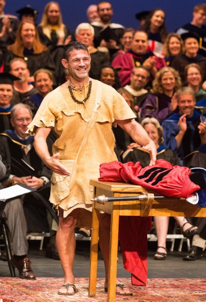 Schindler shows off his handmade buckskin tunic at Fall Convocation.
