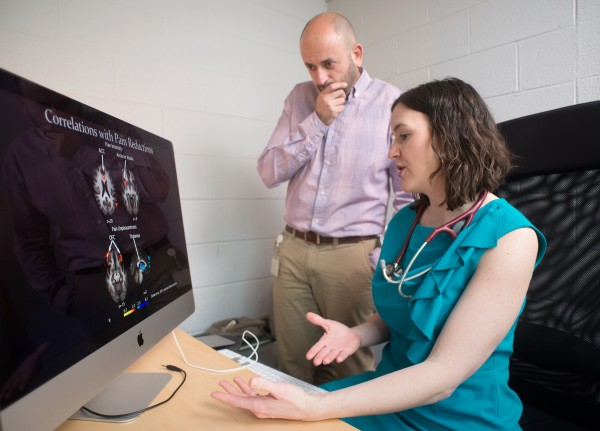 Rebecca Erwin Wells, M.D., and Fadel Zeidan, Ph.D., of Wake Forest Baptist Medical Center review brain-scan images related to their research into the effects of meditation.