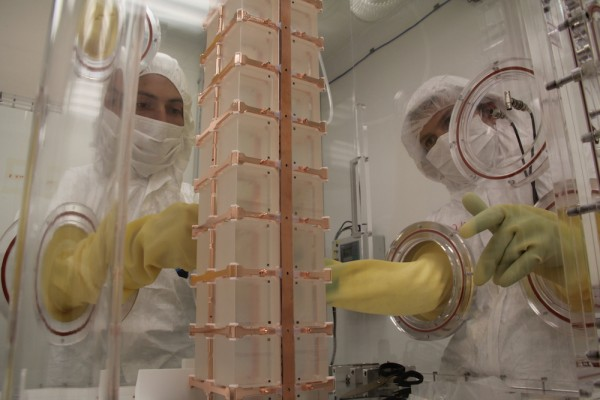 Assembling the crystal tower used in the CUORE experiment