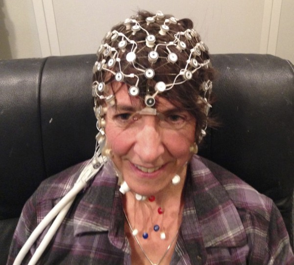 An adult with EEG sensors to record the brain's response to sound.