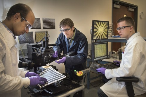 Center for Functional Nanomaterials collaborators (left to right) Atikur Rahman, Kevin Yager, and Pawel Majewski examining the precise, custom-designed nanoscale grids scene on the monitors.