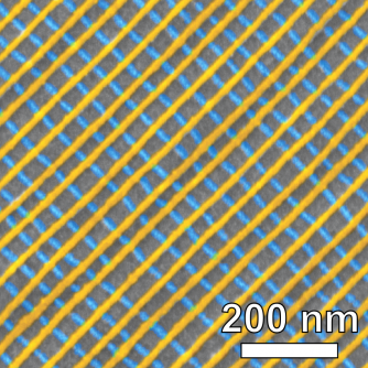 Scanning electron microscope image of a self-assembled platinum lattice, false-colored to show the two-layer structure. Each inner square of the nanoscale grid is just 34 nanometers on each side.