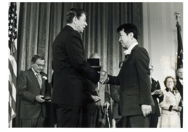 Yoichiro Nambu receives the National Medal of Science from President Ronald Reagan in 1983.