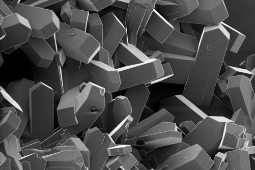 These coffin-shaped growths make up one variety of porous materials called zeolites. An international team of scientists discovered that when aluminum atoms in the material cluster in the overlapping intersections of these sub-units, zeolites lose their ability to convert oil to gasoline and other chemicals.