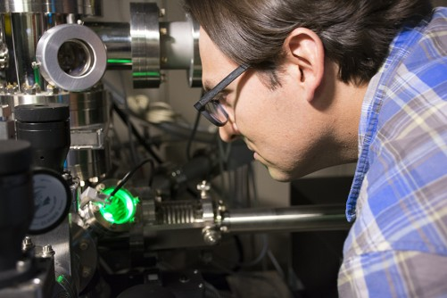 Pacific Northwest National Laboratory materials scientist Danny Perea looks into an atom probe, which he and an international team of scientists used to locate aluminum clusters responsible for the shutdown of catalytic activity in zeolites, a material used by industry to produce fuel and other chemicals.