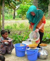 Dankovich pours contaminated pond <a href='/news/tags/_Water'>water</a> into a funnel containing an antimicrobial filter paper to obtain clean drinking <a href='/news/tags/_Water'>water</a> in a rural area of Bangladesh....