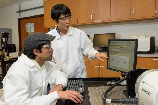 Liyun Wang (standing), assistant professor of mechanical engineering, works with Ashutosh Parajuli, a doctoral student in the College of Engineering, on research concerning diabetes and bone health.