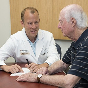 Eric J. Lenze, MD, consults with patient Daniel Viehmann. Lenze led a multicenter study that found that adding a second drug can relieve depression in many older adults whose symptoms don't resolve after treatment with a standard antidepressant drug.