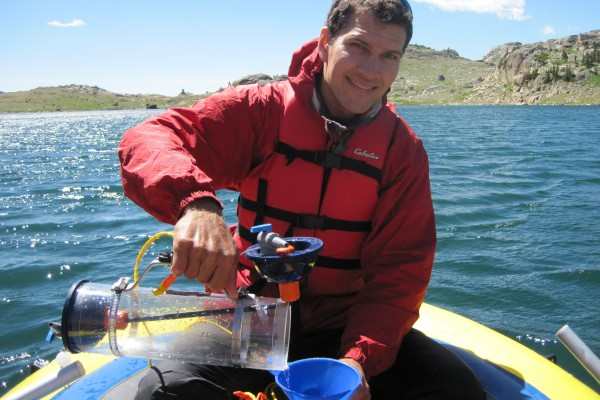 Researcher Kevin Rose samples water from Heart Lake in Montana