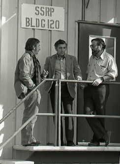Three pioneers of X-ray science talk outside the building of the Stanford Synchrotron Radiation Project (SSRP) at SLAC in 1977 (left to right): Sebastian Doniach, Arthur Bienenstock and Herman Winick. SSRP evolved into today's SSRL X-ray light source.