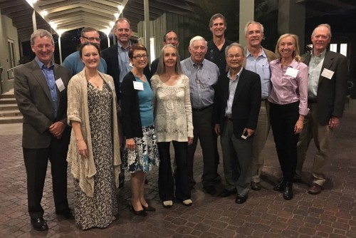 Arthur Bienenstock surrounded by former graduate students at the Oct. 10 symposium in his honor.