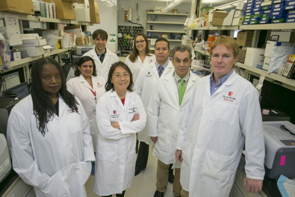 Dr. Ellen Li, center, and colleagues are investigating GI cancer biology in race and ethnicity. Members of Dr. Li's research team include, from left: Dr. Jennie Williams, Suman Grewal, Matthew Murray, Leahana Rowehl, Dr. Juan Carlos Bucobo, Dr. Joel Salz, and Dr. Gerardo MacKenzie.