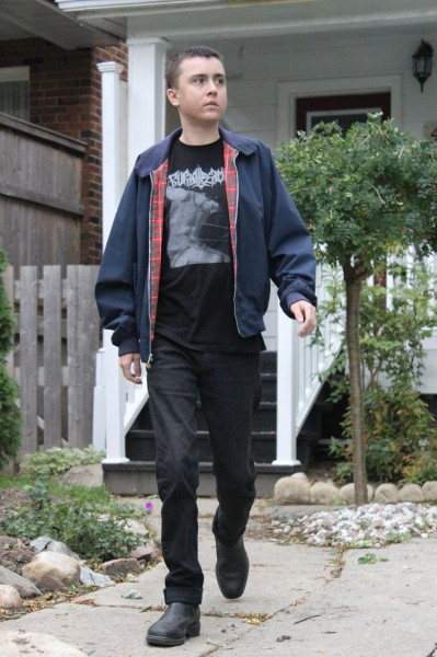 Triple transplant recipient Reid Wylie, 19, goes for a walk outside his home a few weeks after discharge following his surgery at Toronto General Hospital.