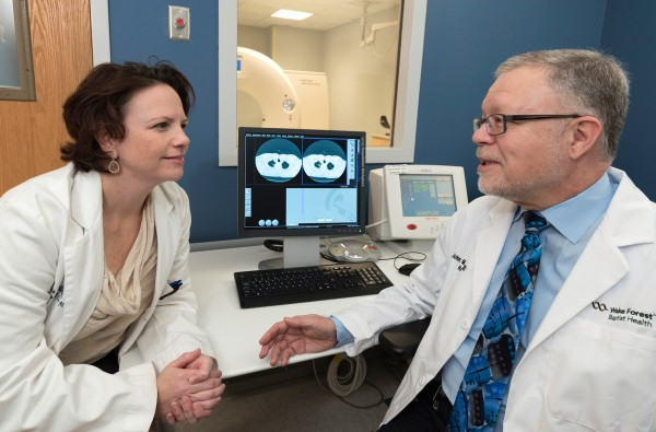 Christina Bellinger, M.D.,  a pulmonologist, discusses an image of patient's lungs captured by a low-dose CT scan with Michael Holbert, M.D., a cardiothoracic radiologist, at Wake Forest Baptist Medical Center.