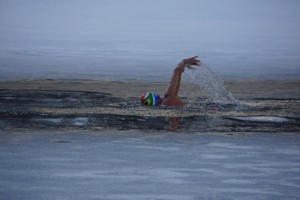 Swimmer glides through icy water