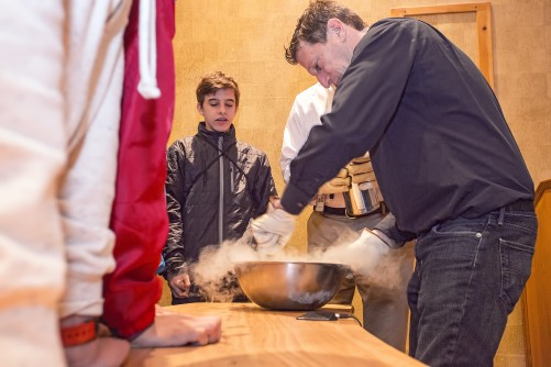 PPPL's Head of Science Education Andrew Zwicker mixes ice cream frozen with liquid nitrogen.