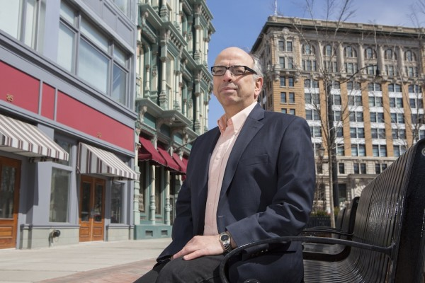 George Homsy, assistant professor of public administration at Binghamton University's College of Community and Public Affairs, photographed in downtown Binghamton.