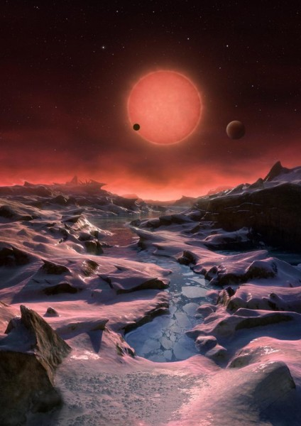 This artist's impression shows an imagined view from the surface one of the three planets orbiting an ultracool dwarf star just 40 light-years from Earth that were discovered using the TRAPPIST telescope at ESO's La Silla Observatory. These worlds have sizes and temperatures similar to those of Venus and Earth and are the best targets found so far for the search for life outside the solar system. They are the first planets ever discovered around such a tiny and dim star. 