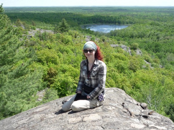 First author Edel O'Sullivan enjoys the sunshine by the Sudbury Crater in Canada.