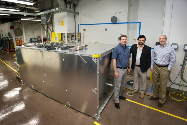 From left, David Dean, Alfredo Galindo-Uribarri and Chris Bryan of Oak Ridge National Laboratory check on a prototype detector at the High Flux Isotope Reactor, a Department of Energy Office of Science User Facility that creates continuous neutron beams. The prototype will mine neutrinos formed as a byproduct of radioactive decay processes for one of three neutrino experiments with major ORNL participation.