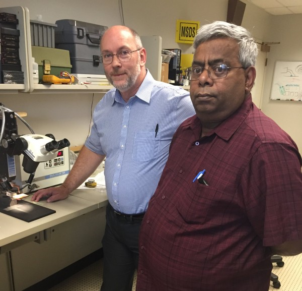 CWRU non-narcotic pain control researchers Kevin Kilgore (left) and Niloy Bhadra in a campus lab