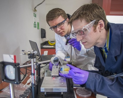 Study co-authors Pawel Majewski and Kevin Yager preparing nanoscale films of self-assembling materials.