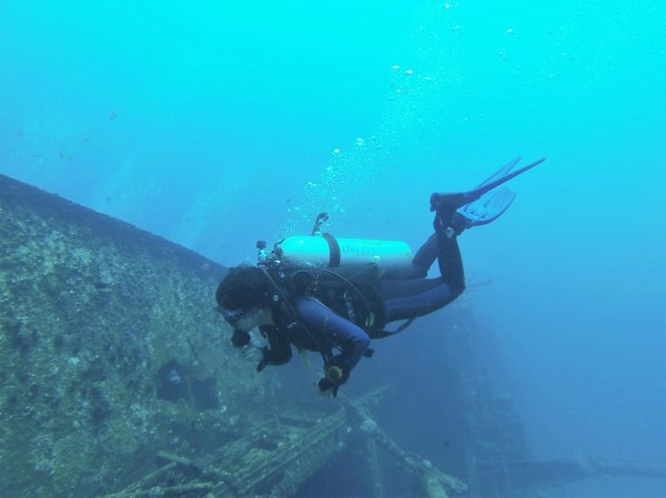 Vinisha Ranna, BDS, lead author and certified stress and rescue scuba diver, swims near underwater wreckage in Sri Lanka.